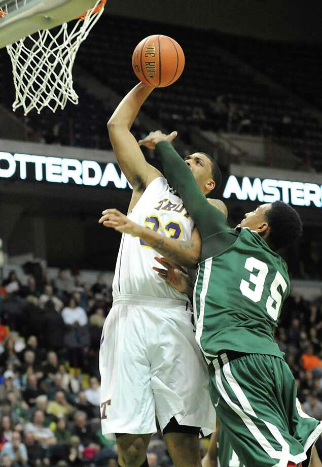 Troy's Imre Megyeri is defended by Green Tech's Ramion Burt as he goes up for two during the Class AA boys' championship basketball game at the Times Union Center on Monday March 4, 2013 in Albany, N.Y.  (Lori Van Buren / Times Union) Photo: Lori Van Buren