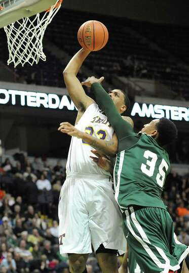 Troy's Imre Megyeri is defended by Green Tech's Ramion Burt as he goes up for two during the Class A