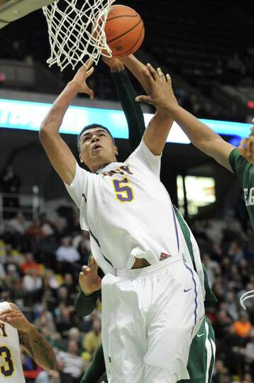 Troy's Javon Ogunyemi drives to the basket during the Class AA boys' championship basketball game ag