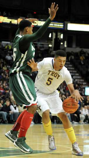 Troy's Javon Ogunyemi dribbles the ball during the Class AA boys' championship basketball game again
