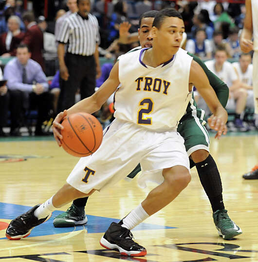 Troy's Jordan Nelson dribbles the ball during the Class AA boys' championship basketball game agains