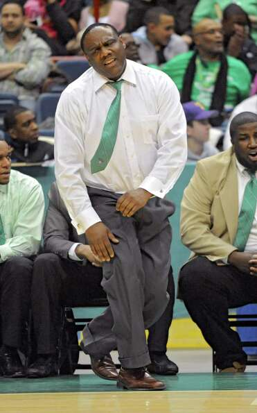Green Tech head coach Jamil Hood reacts during the Class AA boys' championship basketball game again