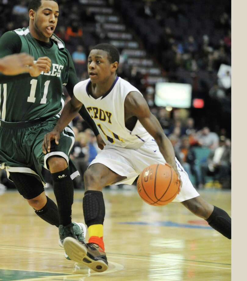 Troy's Dyaire Holt dribbles the ball during the Class AA boys' championship basketball game against Green Tech at the Times Union Center on Monday March 4, 2013 in Albany, N.Y.  (Lori Van Buren / Times Union) Photo: Lori Van Buren