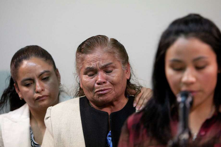 Francisca Cortes stands with her mother, Josefa Cortes, center, as her granddaughter, Lesly Cortes, speaks during a news conference Monday, March 4, 2013, in Houston. Josefa's husband, Maglorio Cortes, was found unconscious in the roadway November 7, 2012 where he was then transported to a hospital. He later died from a gunshot wound. ( Cody Duty / Houston Chronicle ) Photo: Cody Duty, Staff / © 2013  Houston Chronicle