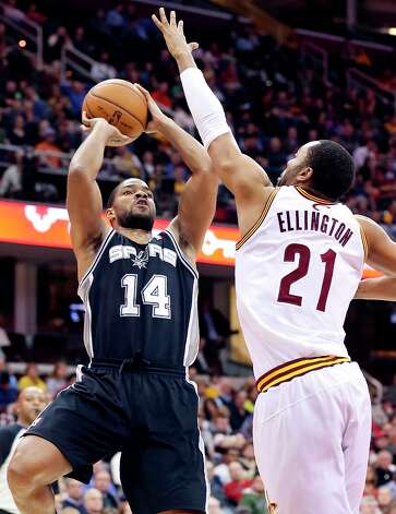 The Spurs' Gary Neal shoots against Cleveland Cavaliers' Wayne Ellington during second half action Wednesday Feb. 13, 2013 at the Quicken Loans Arena in Cleveland, Ohio. The Spurs won 96-95. Photo: Edward A. Ornelas, San Antonio Express-News / © 2013 San Antonio Express-News