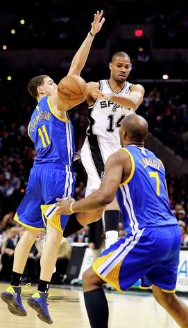 The Spurs' Gary Neal passes between Golden State Warriors' Klay Thompson and Carl Landry during second half action Friday Jan. 18, 2013 at the AT&T Center. The Spurs won 95-88. Photo: Edward A. Ornelas, San Antonio Express-News / © 2012 San Antonio Express-News
