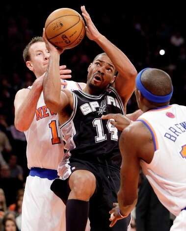 New York Knicks forwards Steve Novak (16) and Ronnie Brewer (11) defend against Spurs guard Gary Neal (14) in the first half at Madison Square Garden in New York, Thursday, Jan. 3, 2013. The Knicks won 100-83. Photo: Kathy Willens, Associated Press / AP