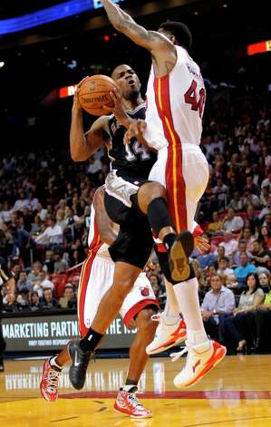 The Spurs' Gary Neal (14) is fouled by Miami Heat's Udonis Haslem (40) in the first half on Thursday, Nov. 29, 2012, in Miami. Photo: Alan Diaz, Associated Press / AP