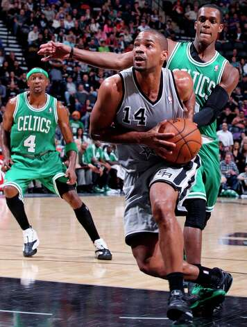 The Spurs' Gary Neal drives around Boston Celtics' Rajon Rondo during first half action Saturday, Dec. 15, 2012 at the AT&T Center. Photo: Edward A. Ornelas, San Antonio Express-News / © 2012 San Antonio Express-News