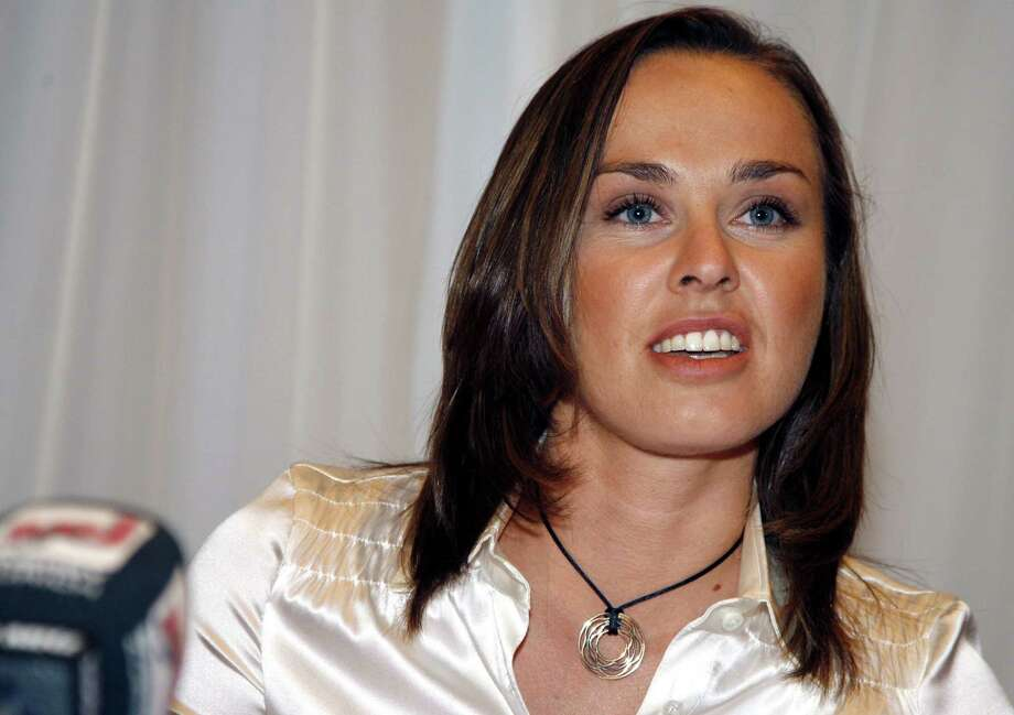 FILE -- This Nov. 1, 2007, file photo shows Swiss tennis player Martina Hingis during a news conference in Glattbrugg, Switzerland. Former No. 1 Martina Hingis won't make a comeback to competitive tennis. The 29-year old Hingis, who retired after getting a two-year ban in 2007 for testing positive for cocaine, said Tuesday, oct. 20, 2009,  in an interview with L'Equipe that she is happy with her new life. (AP Photo/Keystone/Walter Bieri/File ) Photo: WALTER BIERI, SUB / KEYSTONE