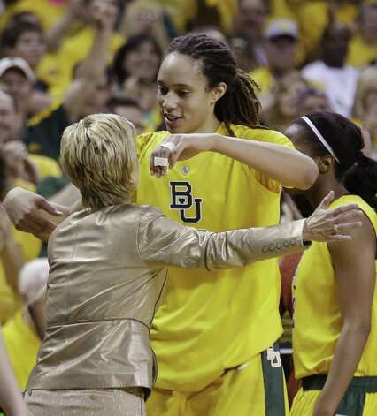 "Baylor's Brittney Griner hugs coach Kim Mulkey. ""Got a dunk finally at home, scored 50. I mean there's not a better way to go out,"" the center said. Photo: L.M. Otero / Associated Press"