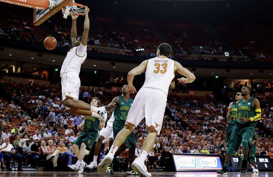 Texas freshman Cameron Ridley, who had a timely assist late in the game, scores two of his eight points the easy way in the first half Monday night. Photo: Eric Gay, STF / AP