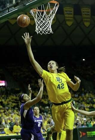 Baylor center Brittney Griner (42) shoots past Kansas State Chantay Caron (11) during the first half of an NCAA basketball game Monday, March 4, 2013, in Waco, Texas. Baylor won 90-86. (AP Photo/LM Otero) Photo: LM Otero, Associated Press / AP
