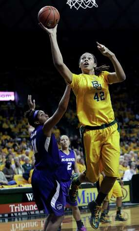 Baylor center Brittney Griner (42) shoots against Kansas State guard Chantay Caron (11) during the first half of an NCAA college basketball game Monday, March 4, 2013, in Arlington, Texas. (AP Photo/LM Otero) Photo: LM Otero, Associated Press / AP