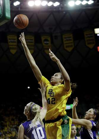 Baylor center Brittney Griner (42) shoots against Kansas State guards Heidi Brown (10) and Brittany Chambers during the first half of an NCAA college basketball game Monday, March 4, 2013, in Arlington, Texas. (AP Photo/LM Otero) Photo: LM Otero, Associated Press / AP