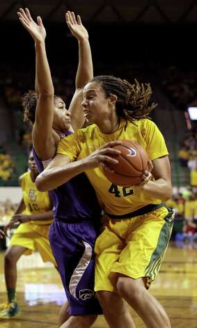 Baylor center Brittney Griner (42) drives against Kansas State guard Chantay Caron (11) during the first half of an NCAA college basketball game Monday, March 4, 2013, in Arlington, Texas. (AP Photo/LM Otero) Photo: LM Otero, Associated Press / AP