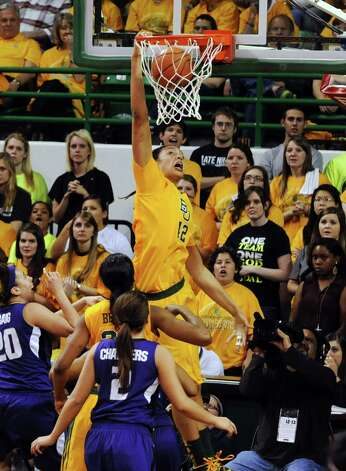 Baylor's Brittney Griner (42) dunks over Kansas State's Bri Craig (20) and Brittany Chambers (2) in the second half of their NCAA college basketball game, Monday, March, 4, 2013, in Waco, Texas. Baylor won 90-68. (AP Photo/The Waco Tribune-Herald, Rod Aydelotte) Photo: Rod Aydelotte, Associated Press / The Waco Tribune-Herald