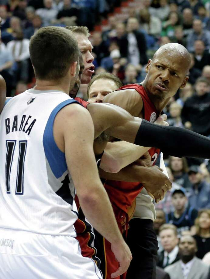 Miami's Ray Allen, right, is separated by a teammate and an official after he was fouled by Minnesota's J.J. Barea in the fourth quarter of Monday's game at Minneapolis. Barea was ejected after he was called for a flagrant foul. The Heat won 97-81. Photo: Jim Mone, STF / AP