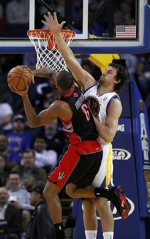 Andrew Bogut (right) made it tough for Alan Anderson to get his shot up in Monday's Warriors win, Bogut's return after missing six games. Photo: Carlos Avila Gonzalez, The Chronicle
