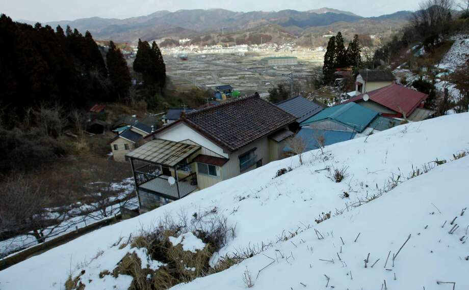 In this Thursday, Feb. 21, 2013 photo, an area devastated by the March 11, 2011 earth quake and tsunami is seen from a higher place in Kesennuma, Miyagi Prefecture. Japan's progress in rebuilding from the tsunami that thundered over coastal sea walls, sweeping entire communities away, is mainly measured in barren foundations and empty spaces. Clearing of forests on higher ground due to be leveled to make space for relocating survivors has barely begun. Japan will next week observes two years from the March 11, 2011 disasters which devastated in the northeastern Pacific coast of the country. Photo: Junji Kurokawa
