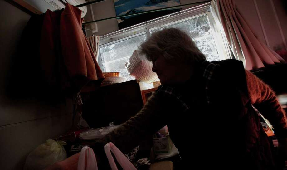 In this Saturday, Feb. 23, 2013 photo, a March 11, 2011 tsunami survivor Hide Sato, 83, sits in a small room she is allotted for one person at a temporary shelter housing complex in Rikuzentakata, Iwate Prefecture. Japan's progress in rebuilding from the tsunami that thundered over coastal sea walls, sweeping entire communities away, is mainly measured in barren foundations and empty spaces. Clearing of forests on higher ground due to be leveled to make space for relocating survivors has barely begun. Japan will next week observes two years from the March 11, 2011 disasters which devastated in the northeastern Pacific coast of the country. Photo: Junji Kurokawa