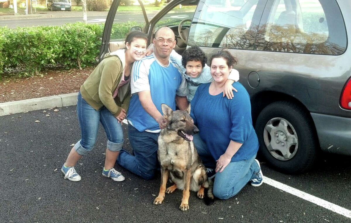 This family in Vancouver, Wash., is fostering this German shepard, Liana, until her owner is released from jail. Eric Michl, the officer who arrested the owner, made the nearly three-hour drive to the family on his day off Monday, March 4.