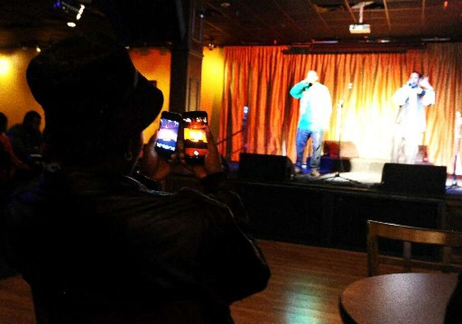 Paper Chaser plays Open Mic Night at the Gig while a patron films it. Randy Edwards/cat5