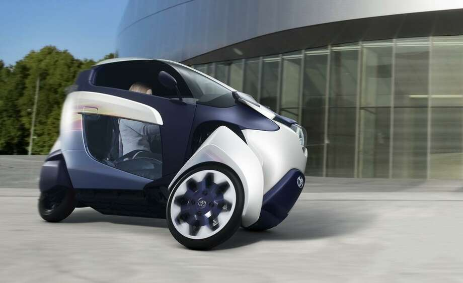 Toyota unveiled a three-wheeled electric vehicle at the Geneva Motor Show. The vehicle is a cross between an electric vehicle and a motorcycle. The car has a driving range of 30 miles. Photo: Toyota Motor Company