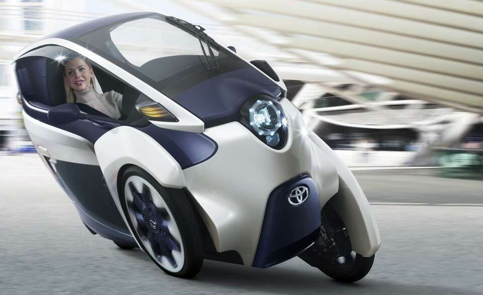 Toyota unveiled a three-wheeled electric vehicle at the Geneva Motor Show. The vehicle is a cross be