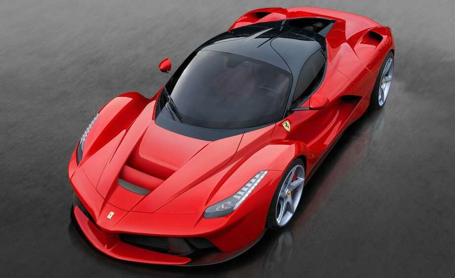 Ferrari unveiled its new 950-horsepower hybrid vehicle at the Geneva Auto Show. The automaker's newest supercar packs a 6.3-liter V12 engine and an electric motor under the hood. It tops out at 230 mph. Photo: Ferrari