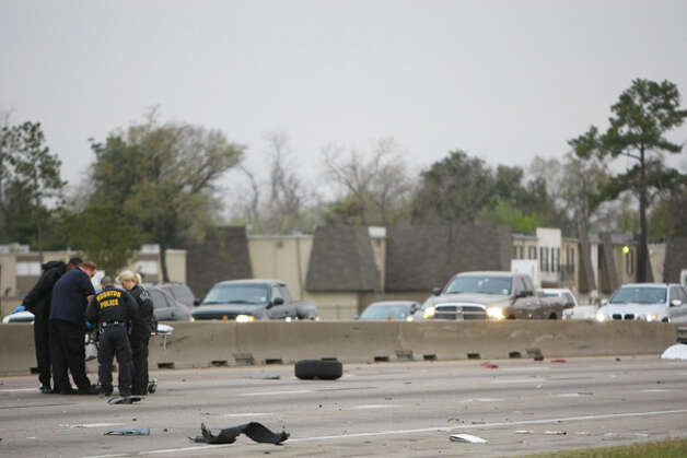 A two-vehicle fatal wreck shut down westbound U.S. 290 at Antoine shortly after 3 a.m. Tuesday. The outbound lanes remained closed during rush hour, and the inbound lanes backed up around the crash site. (Cody Duty / Houston Chronicle) Photo: .