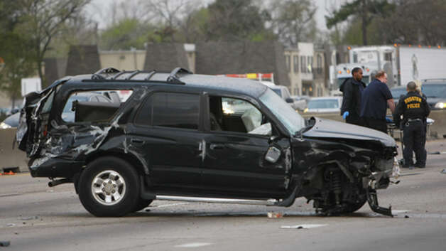 A two-vehicle fatal wreck shut down westbound U.S. 290 at Antoine shortly after 3 a.m. Tuesday. The outbound lanes remained closed during rush hour, and the inbound lanes backed up around the crash site. (Cody Duty / Houston Chronicle)