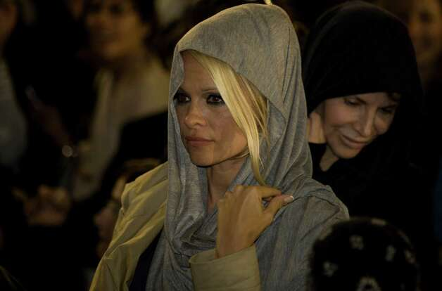 "U.S. actress Pamela Anderson is seen at the Western Wall, Judiasm's holiest site, in Jerusalem's Old City, Sunday, Nov. 7, 2010.  Former ""Baywatch"" star Pamela Anderson said Sunday she will try her powers of seduction while in Israel on an unlikely audience,  ultra-Orthodox Jewish lawmakers. Anderson, an honorary director of People for the Ethical Treatment of Animals, is in Israel to participate in the local version of ""Dancing with the Stars."" (AP Photo/Sebastan Scheiner) Photo: Sebastian Scheiner / AP"