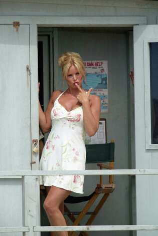 Gena Lee Nolin blows a kiss to the photographer after performing a scene in a lifeguard tower for a made-for TV movie in 2002. Photo: Phil Mislinski, Getty Images / Getty Images Europe
