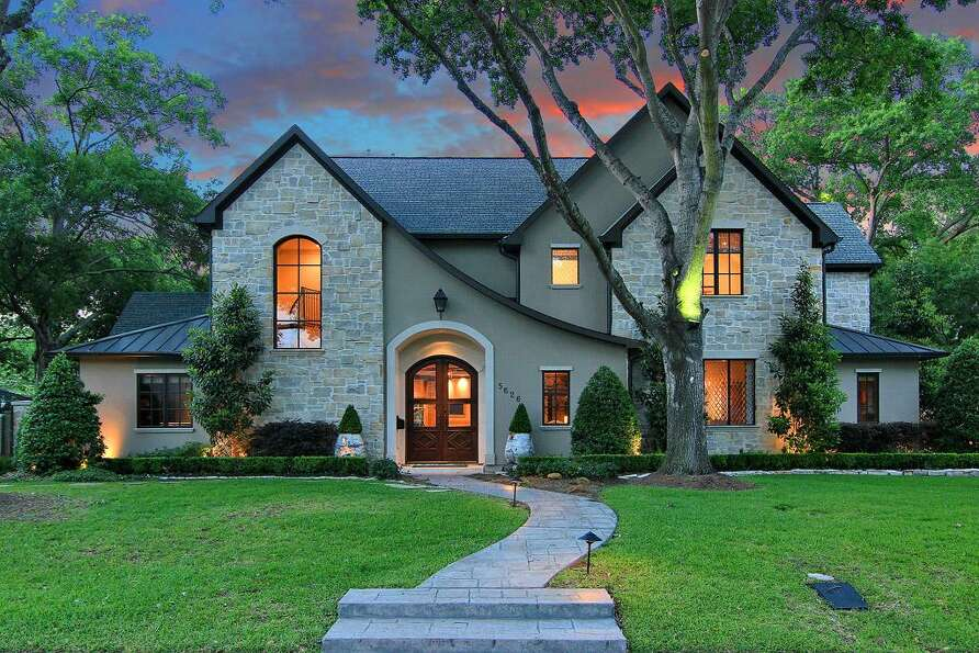 Magnificent stucco and stone custom home built on a quiet tree lined street in the conveniently loca