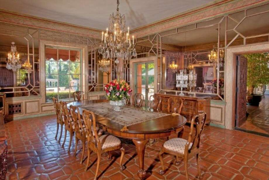 Slightly dated but certainly imposing dining room.  All photos via Trulia Luxe and MLS.