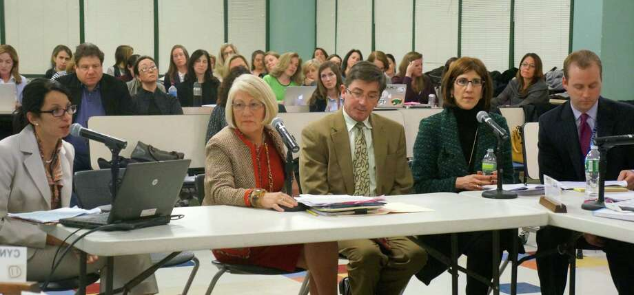 Education administrators present a proposal to change instructional times for elementary-school students, a plan that would include the introduction of five days of full-day kindergarten. From left, in the front row, are: Kings Highway Elementary School Principal Susie Da Silva; Director of Elementary Education Cynthia Gilchrest; Long Lots Elementary School Principal Rex Jones; Saugatuck Elementary School Principal Julie Droller and Greens Farms Elementary School Principal John Bayers. Photo: Paul Schott / Westport News