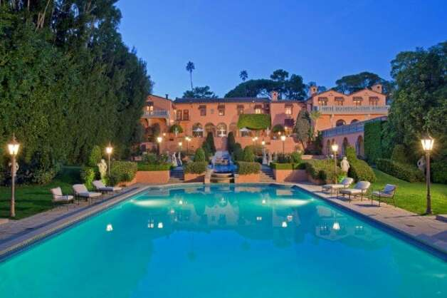 Ornate, extra-long pool.  All photos via Trulia Luxe and MLS.
