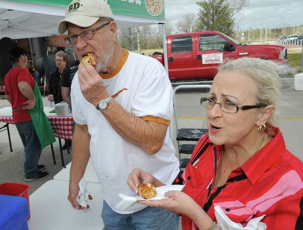 Charles and Deborah Sanford, enjoy slices of the brick oven pizza from Divina La Pizza who was at the event for the first time.  The downtown Lunch on the Lake event, held at the Beaumont Event Centre in downtown Beaumont, started again this year on Monday March 4, 2013.  The vendors have moved to the street area directly adjacent to the Great Lawn, not by the lake like they were last year. Dave Ryan/The Enterprise