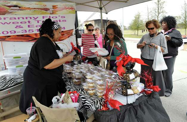 At the Granny Flo's Sweet Treats & Eats booth, Janice Solomon, keeps up with her line as the noon hour wore on. The downtown Lunch on the Lake event, held at the Beaumont Event Centre in downtown Beaumont, started again this year on Monday March 4, 2013.  The vendors have moved to the street area directly adjacent to the Great Lawn, not by the lake like they were last year. Dave Ryan/The Enterprise