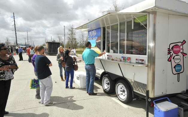 The line for cuban sandwiches at MiMi's got a little bit longer as the noon hour arrived.  The downtown Lunch on the Lake event, held at the Beaumont Event Centre in downtown Beaumont, started again this year on Monday March 4, 2013.  The vendors have moved to the street area directly adjacent to the Great Lawn, not by the lake like they were last year. Dave Ryan/The Enterprise