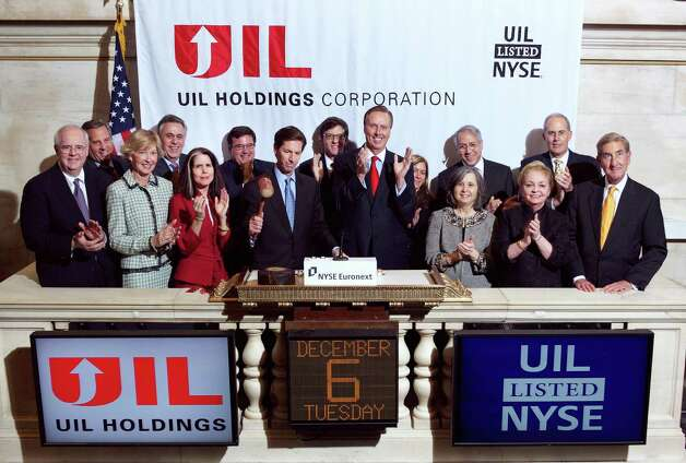UIL Holdings Corp. executives and board members rang the closing bell at the New York Stock Exchange on Tuesday, Dec. 6 to celebrate the company's 40th anniversary of trading. Chief Executive Officer James P. Torgerson is holding the gavel on the podium; to his immediate right is John Lahey, non-executive chairman; at the far left is Rich Nichols, chief financial officer. Photo: Contributed Photo