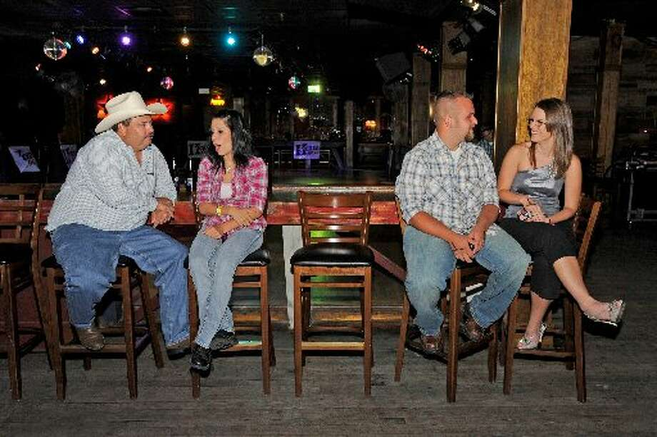 Dixie Dance Hall patrons, from left, Danny Evans, Brenna Heatherly, Tyler Hall and Loren Lindsey enjoy an evening at the Crockett Street club. Valentino Mauricio/cat5