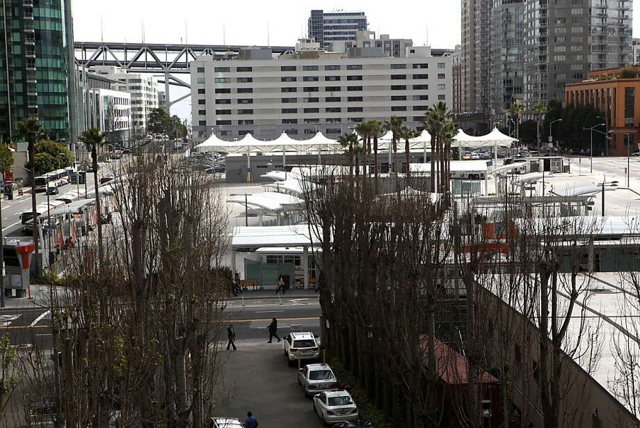 The temporary Transbay terminal sits less than a block away from  Transbay Center construction in San Francisco, Calif., on Monday, March 4, 2013. Photo: Liz Hafalia, The Chronicle