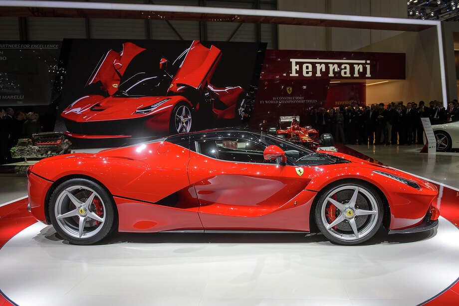 The new La Ferrari hybrid model car is unveiled in World premiere at Italian car maker's booth during the 83rd Geneva Motor Show on March 5, 2013. The Geneva International Motor Show opens its doors under a dark cloud, with no sign of a speedy rebound in sight for the troubled European market. The event, which is considered one of the most important car shows of the year, will again be heavily marked by the crisis in Europe after an already catastrophic year in 2012. Photo: FABRICE COFFRINI, AFP/Getty Images / 2013 AFP