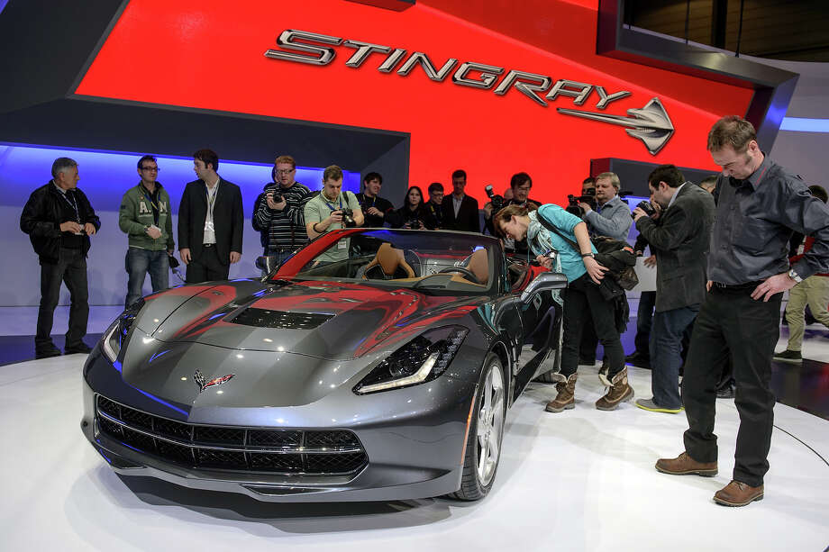 Visitor looks during the World premiere preview of the new Chevrolet Corvette Stingray Cabriolet at the car maker's booth on March 4, 2013 on the eve of the press day of Geneva Motor Show in Geneva. Photo: FABRICE COFFRINI, AFP/Getty Images / 2013 AFP