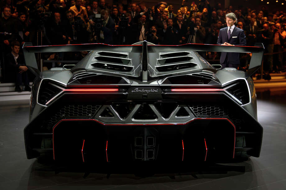 The new Lamborghini Veneno is presented by CEO and Chairman Stephan Winkelmann during a preview of Volkswagen Group on March 4, 2013 ahead of the Geneva Car Show in Geneva. Photo: FABRICE COFFRINI, AFP/Getty Images / 2013 AFP
