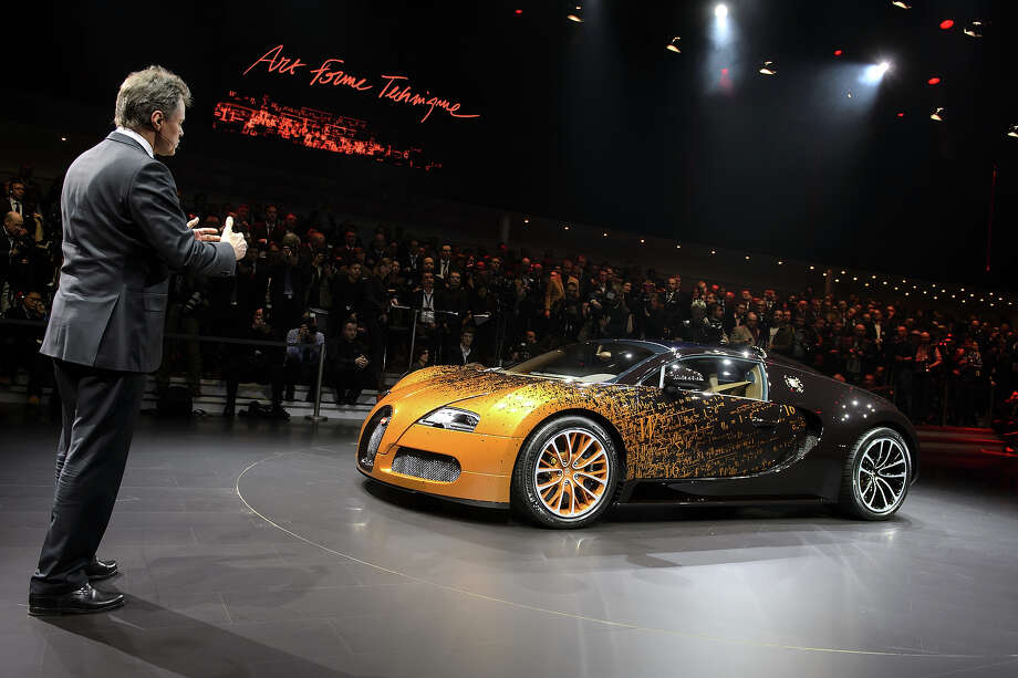 The new Bugatti Grand Sport Venet model car is introduced by CEO and Chairman Wolfgang Schreiber during a preview of Volkswagen Group on March 4, 2013 ahead of the Geneva Car Show in Geneva. Photo: FABRICE COFFRINI, AFP/Getty Images / 2013 AFP