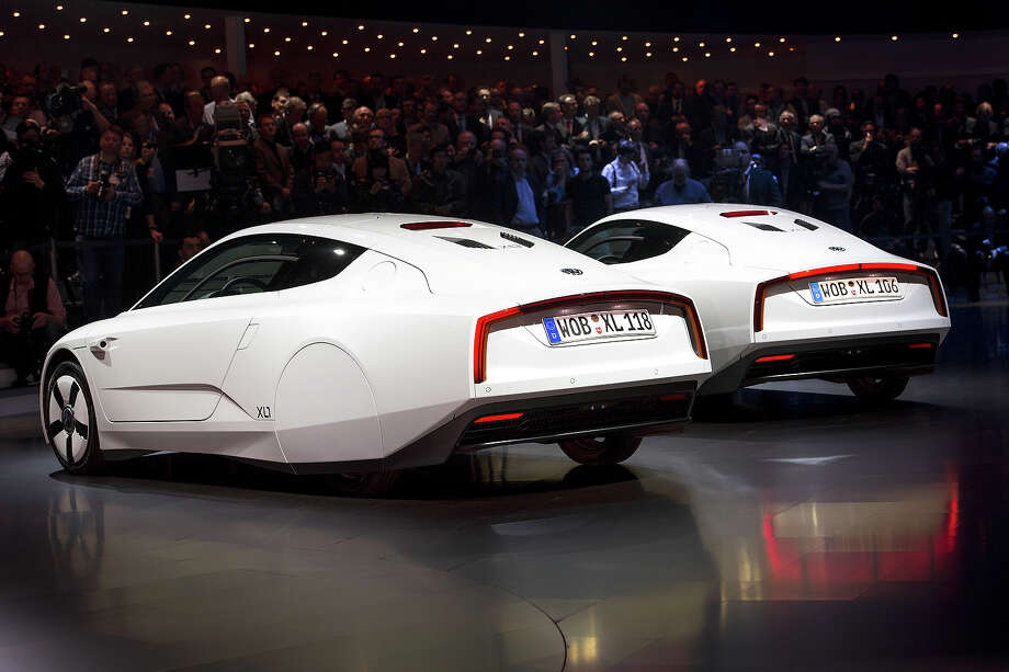 Two new Volkswagen hybrid XL1 model cars are displayed during a preview of Volkswagen Group on March 4, 2013 ahead of the Geneva Car Show in Geneva. Photo: FABRICE COFFRINI, AFP/Getty Images / 2013 AFP