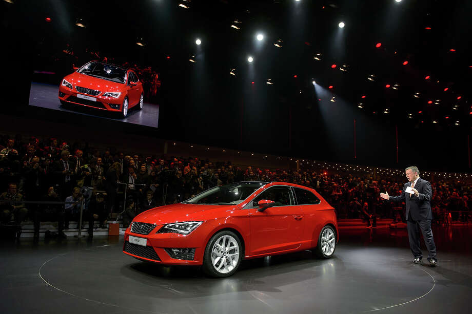 A new Seat Leon SC model car is presented by CEO and Chairman James Muir during a preview of Volkswagen Group on March 4, 2013 ahead of the Geneva Car Show in Geneva. Photo: FABRICE COFFRINI, AFP/Getty Images / 2013 AFP